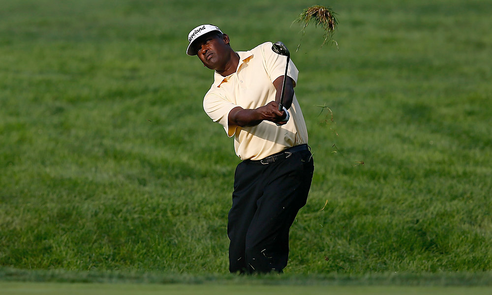 Vijay Singh fired a 66 to capture the lead.