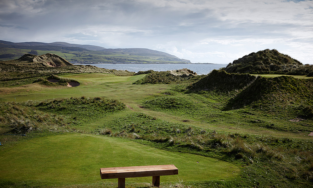 "Machrihanish Dunes Golf Club 14th (par 3, 129 yards)                       LOCAL KNOWLEDGE: ""The green looks far away against its spectacular backdrop, but try to believe the yardage on the scorecard. It is no more than it reads and it is better to be short here."" - David McLay Kidd, course designer"