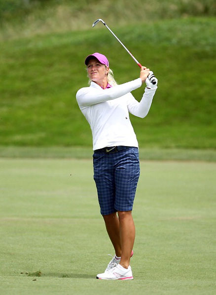 7. Good for the Sand                       There were shorts, short-shorts, skorts (a skirt-short hybrid), and many variations on capri pants. These checked bottoms on Suzann Pettersen begged description: Were they long Bermudas? Capris? Or sophisticated golf clamdiggers? In any event, nice.