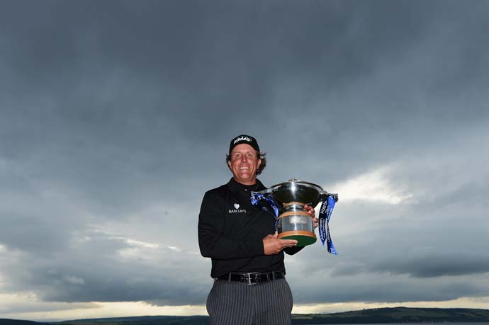 Phil Mickelson poses with the Scottish Open trophy after his first-ever win in the UK.