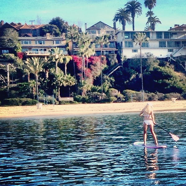 From Natalie Gulbis' Instagram:                           My favorite workout! Paddle boarding.. And a beautiful morning to be out on the water
