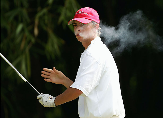 Spencer Levin exhales smoke before hitting a tee shot during the 2004 World Amateur Championships in Puerto Rico.