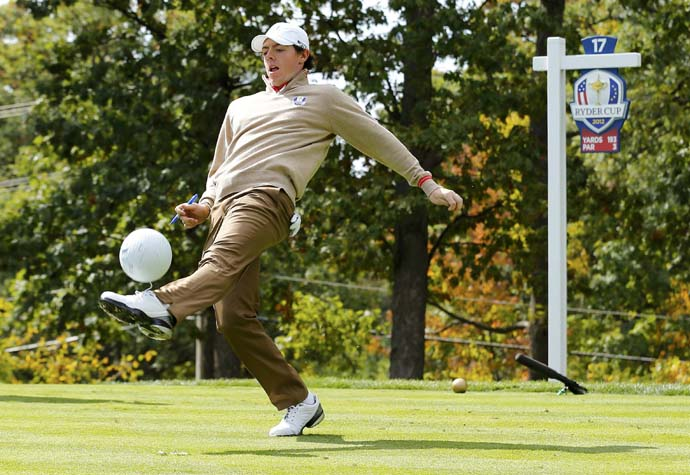Rory McIlroy: SoccerMcIlroy has some fun with an oversized golf ball at the 2012 Ryder Cup at Medinah. McIlroy is a Manchester United supporter and regularly tweets about the team.