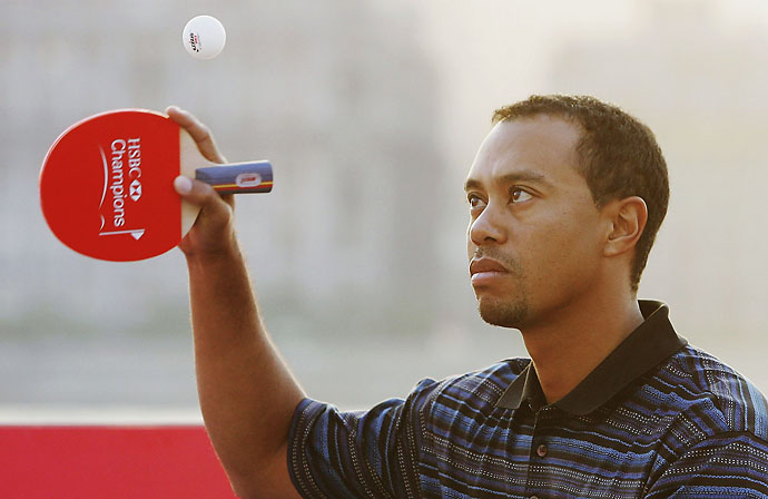 Tiger Woods: Ping-PongWoods plays ping-pong in Shanghai in 2006. Apparently he has a ping-pong game face to go along with his golf game face.