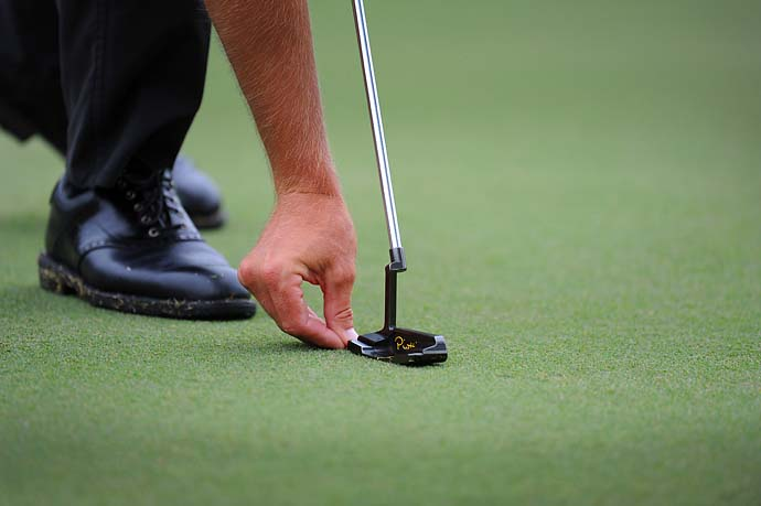 Henrik Stenson places his ball marker down on the fourth green during the third round of the Tour Championship on Saturday.