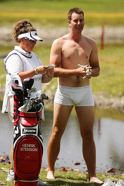 "removed his clothes, on the par-4 third hole during the first round of the WGC-CA Championship,to hack a ball out of the mud.                                                       function fbs_click() {u=""http://www.golf.com/golf/gallery/article/0,28242,1885005,00.html"";t=document.title;window.open('http://www.facebook.com/sharer.php?u='+encodeURIComponent(u)+'&t='+encodeURIComponent(t),'sharer','toolbar=0,status=0,width=626,height=436');return false;} html .fb_share_link { padding:2px 0 0 20px; height:16px; background:url(http://b.static.ak.fbcdn.net/images/share/facebook_share_icon.gif?8:26981) no-repeat top left; }Share on Facebook                                                      E-mail these photos to a friend."