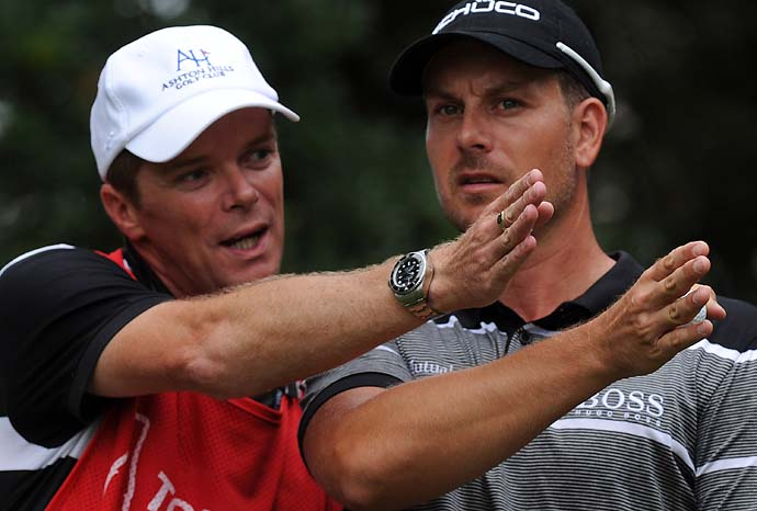 Caddie Gareth Lord and Henrik Stenson talk about the wind direction on the third tee box during the third round of the Tour Championship on Saturday.