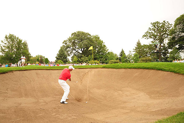 had a rough day of it, skulling this shot out of the bunker for a double bogey on five. He shot one-over 73.