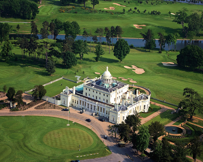 """Stoke Park -- Buckinghamshire, England                       The Stoke Park clubhouse, adapted from the historic mansion of 1790, was the setting for the James Bond film, """"Goldfinger."""" A memorable scene featuring Bond, Goldfinger and OddJob took place on the 18th green with the façade of the clubhouse as the background."""