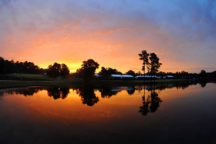 The sun rises behind the 17th before the start of the third round of the Tour Championship on Saturday. The weather was all downhill from then.