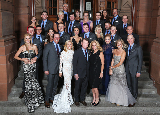Phil Mickelson, Keegan Bradley, vice captain Andy North, Bubba Watson, Matt Kuchar, vice captain Steve Stricker, Rickie Fowler, Jordan Spieth, Patrick Reed, Hunter Mahan, vice captain Raymond Floyd, Webb Simpson, Zach Johnson, Tom Watson, Captain of the United States, Jimmy Walker and Jim Furyk of the United States team pose with wives and partners.