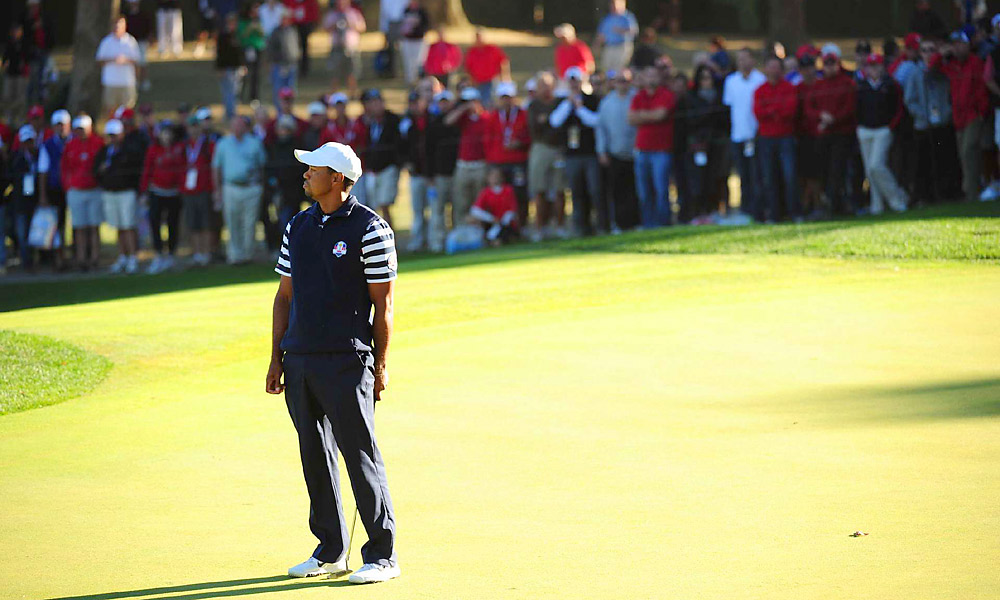 Tiger Woods won the 17th hole to move 1 up on Francesco Molinari in the anchor match, but by the time they hit their drives on 18, Kaymer had made his putt and the competition was over. They ended up halving the match.