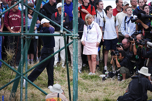 Woods tangled with a TV tower early in his round.