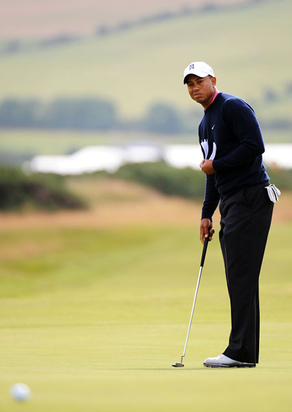 Monday at Turnberry                                                      Tiger Woods, who hasn't won a major tournament in 2009, was out early Monday for a practice round.