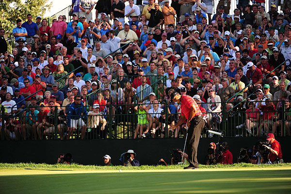 With only a few holes left to regain the lead, Woods missed critical putts, including this one for par on the 17th green.