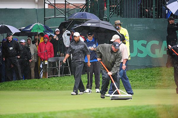 On the sixth hole, the squeegees were out.