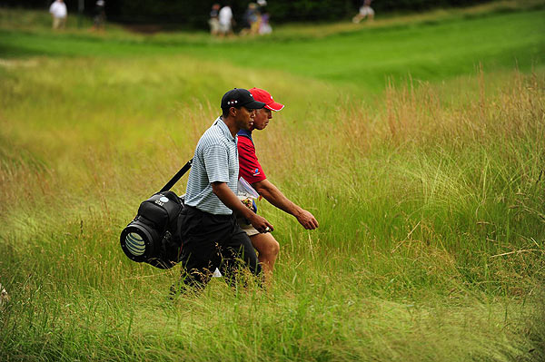 "Saturday at Bethpage Black                           After an extended break due to rain delays, Tiger Woods returned to Bethpage Saturday morning for his second round.                                                       function fbs_click() {u=""http://www.golf.com/golf/gallery/article/0,28242,1905392,00.html"";t=document.title;window.open('http://www.facebook.com/sharer.php?u='+encodeURIComponent(u)+'&t='+encodeURIComponent(t),'sharer','toolbar=0,status=0,width=626,height=436');return false;} html .fb_share_link { padding:2px 0 0 20px; height:16px; background:url(http://b.static.ak.fbcdn.net/images/share/facebook_share_icon.gif?8:26981) no-repeat top left; }Share on Facebook                                                                                                                                                                                                                        addthis_pub             = 'golf';                                                       addthis_logo            = 'http://s9.addthis.com/custom/golf/golf_logo.jpg';                                                      var addthis_offset_top = -155;                                                      addthis_logo_color      = '555555';                                                      addthis_brand           = 'Golf.com';                                                      addthis_options         = 'email, facebook, twitter, digg, delicious, myspace, google, reddit, live, more'                                                                                                                                                                    Share"
