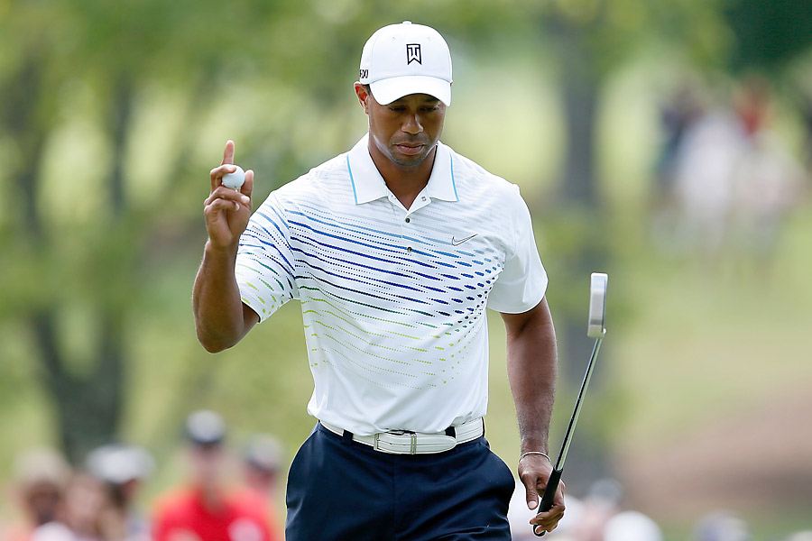 Woods made a long birdie putt at the second hole to get into red numbers.