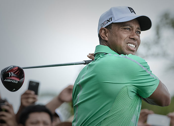 Before Tiger broke his 4-iron on a tree at the 2007 Masters, he tried this shot at the 1992 Los Angeles Open.