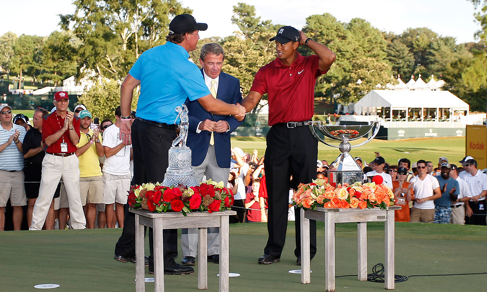 2009: Tiger Woods                           Woods became the first two-time winner of the FedEx Cup, while Phil Mickelson won the Tour Championship. The two rivals shared a handshake and trophy ceremony following the event.