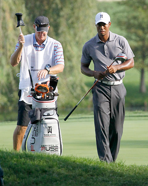 The Pro-Am tournament of the BMW Championship was held Wednesday morning at Crooked Stick Golf Club. Here, Tiger Woods and Joe LaCava walk to the ninth tee.