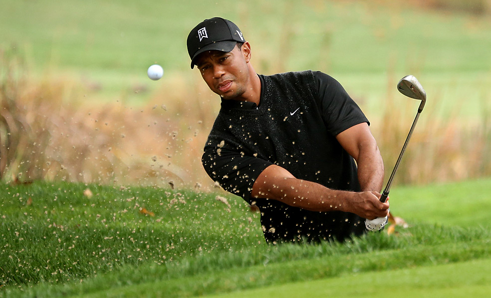 Tiger Woods birdied three of the last five holes on Saturday to finish five shots off the lead.