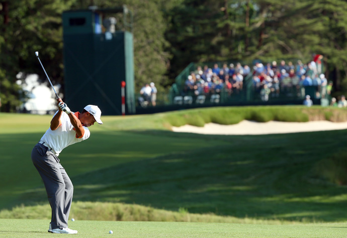 Woods, McIlroy and Masters champion Adam Scott tee off together Thursday at 1:14 p.m. ET.