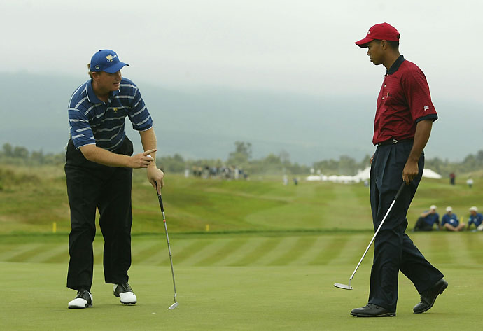Tiger Woods and Ernie Els during their legendary singles match at the 2003 Presidents Cup in South Africa. Jack Nicklaus and Gary Player agreed to a tie after Woods and Els played sudden-death holes into darkness.