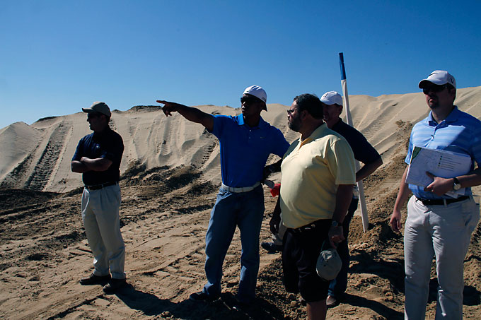 The following front-nine photos were taken earlier in the construction process while Golf Magazine's Joe Passov (front, left) toured the site with Tiger.