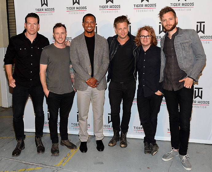 Tiger Woods with the band OneRepublic. The pop rockers were the main attraction at Tiger Jam 14, a change from harder-rocking acts like Van Halen, Kid Rock and No Doubt that have headlined past Tiger Jams.