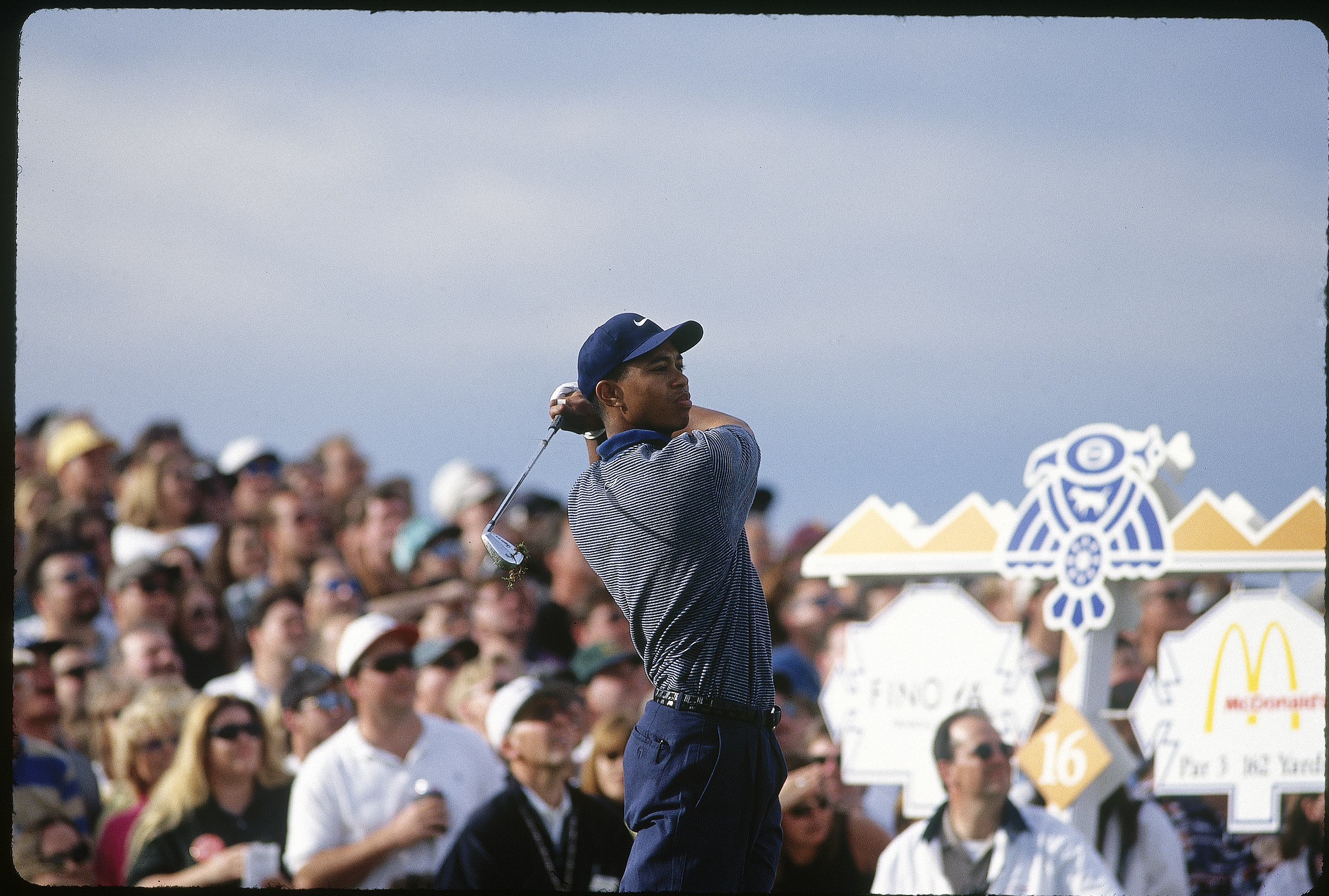 Woods holds his follow-through after his tee shot on 16. We're guessing that one felt good.