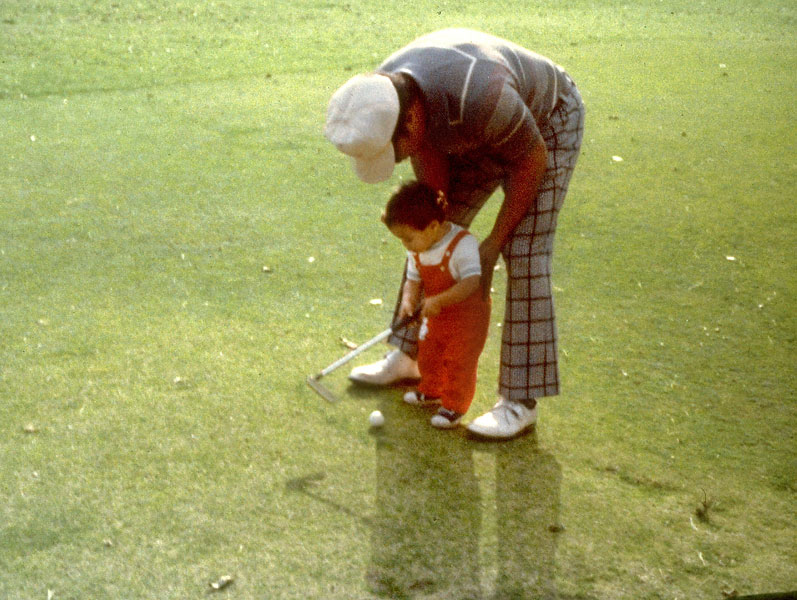 At 1, Tiger Woods was already golfing with some help from his father, Earl.