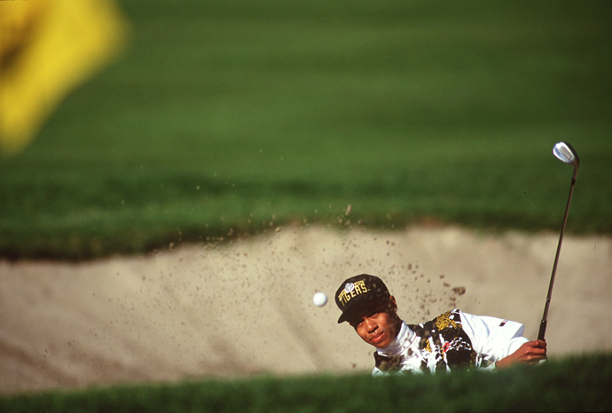 Tiger hits a bunker shot at the 1993 L.A. Open. Woods has played the event 11 times and has never won there. It's the most times he has played a tournament without a win.
