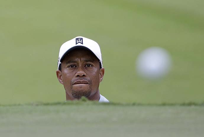 Tiger Woods hits out of the bunker onto the 16th green during the third round of play in the Tour Championship on Saturday.
