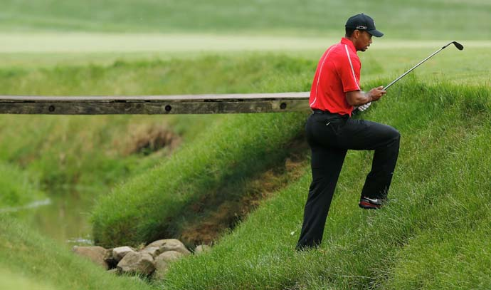 Tiger Woods climbs out of a creek after hitting his second shot on the 11th hole on Sunday. Woods shot even par on Sunday after posting a 79 on Saturday. Woods had two triple-bogeys this week at the Memorial. His record for most triple-bogeys or worse is three at the 1997 British Open (2 triple-bogeys and 1 quadruple-bogey).