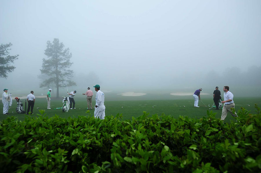 Several other players joined Woods on the range.