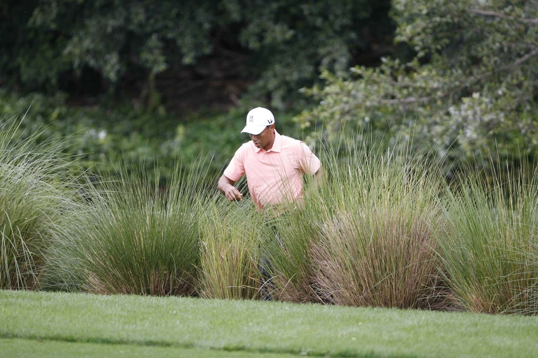 """It was only half-submerged, so I could play some kind of explosion shot and get it back in the fairway,"" Tiger said."