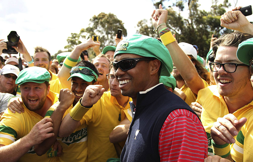 Tiger Woods                           Reason to Celebrate: Woods won his singles match against Aaron Baddeley to secure the winning point for the U.S. team at the Presidents Cup.
