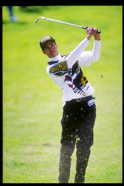Woods sticks out his tongue Michael Jordan-style as he watches a wedge shot at the 1993 L.A. Open.