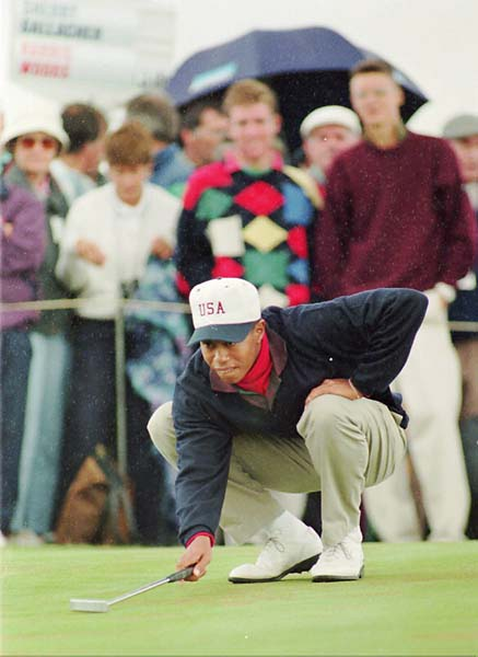 Tiger Woods lines up a putt at the 1995 Walker Cup. Woods, who suffered from food poisoning during the event, lost in singles to unheralded Gary Wolstenholme.
