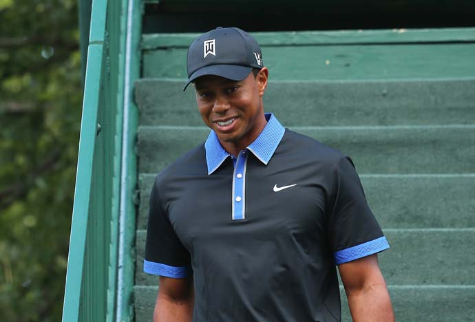 Tiger Woods didn't spend too much time celebrating his Bridgestone victory. He showed up on the driving range at Oak Hill on Monday.