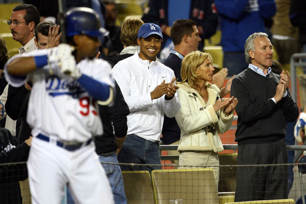 Tiger Woods cheered on Manny Ramirez during the game, with Dodgers owner Frank McCourt and his wife Dodgers vice chairman and president Jamie McCourt.