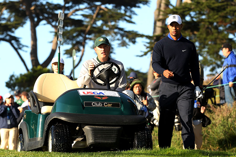 Former Stanford teammates Casey Martin and Tiger Woods played a practice round Tuesday before the U.S. Open at Olympic.