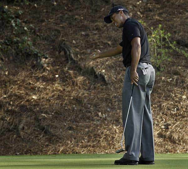 Tiger, pleading with his ball to change direction, left this birdie putt short on Friday on the 12th hole.
