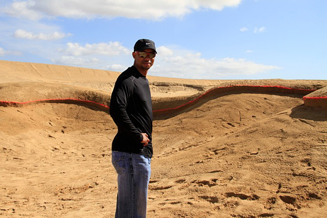 "Woods tweeted, ""Things are really starting to take shape."" Here, he's standing on the edge of what will soon be a bunker in the third-hole fairway. (You can see its outline traced in red.)More information at diamantecabosanlucas.com"