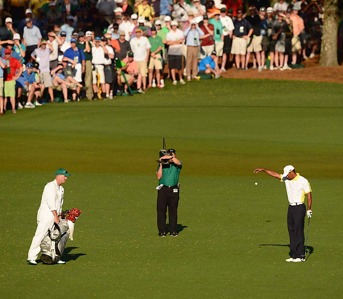 "The holy grail of rules incidents, Tiger Woods was penalized two strokes after-the-fact for making an illegal drop on the 15th hole in the second round of the 2013 Masters, despite having signed an incorrect scorecard, which normally leads to a disqualification. Woods did not know he had broken a rule, and it was only when the Augusta officials investigated it after the round that the violation was noticed. Why wasn't he disqualified? Augusta officials cited relatively new Rule 33 that states ""that disqualification can be waived at the committee's discretion."""
