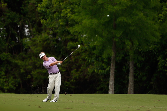 David Toms, an LSU grad, made four birdies and no bogeys to make the cut.