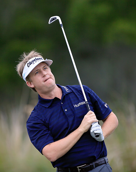 David Toms matched Love and Johnson at five under.