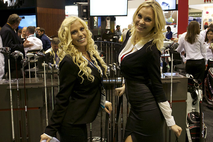Models Chelsey Voogt, left, and Ashley M. Lands greet guests at the Tour Edge booth at the Orlando Convention Center on Wednesday.
