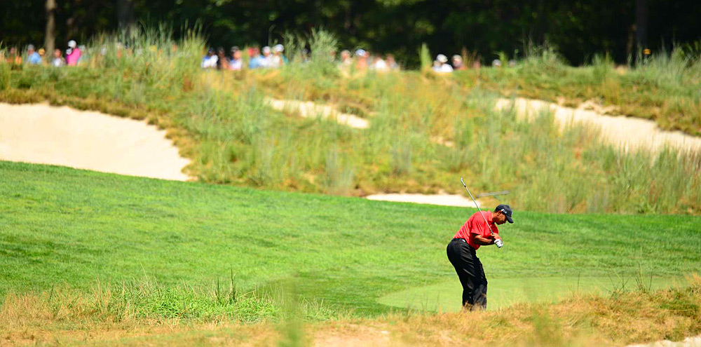 Woods made a double bogey, six bogeys and three birdies.